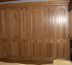 Panelled solid oak fitted wardrobes