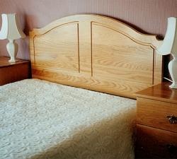 Solid Oak headboard and two bedside cabinets