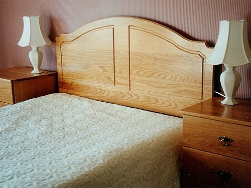 Solid Oak headboard and two bedside cabinets