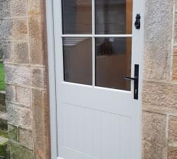 Handpainted door with Kirkpatrick hand forged handles