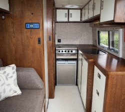 Stylish kitchen with curved corners for a motorhome