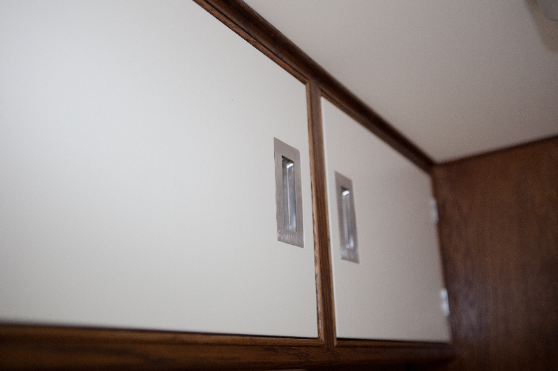 Bespoke overhead cupboards in a van conversion