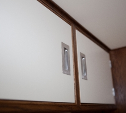 Bespoke overhead cupboards in a van conversion