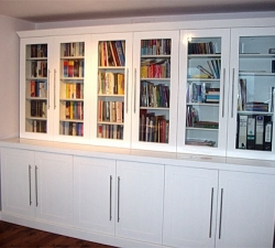 Painted bookcase with storage cupboards