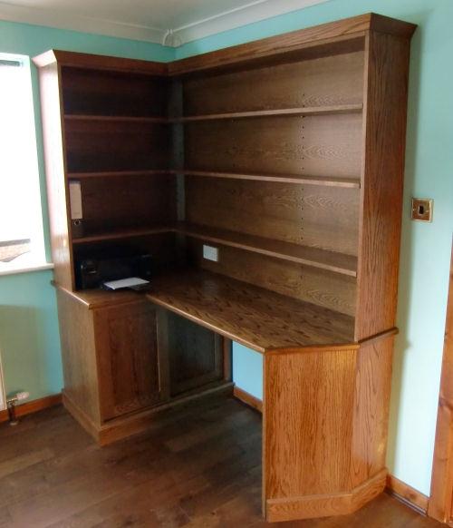 Oak corner office desk with shelving