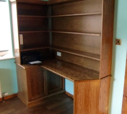 Oak corner office desk with shelving