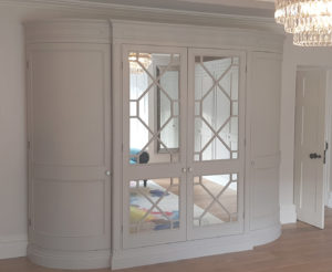 Curved wardrobe with glass doors